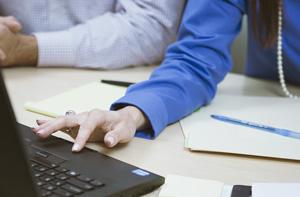 hands-laptop-paper